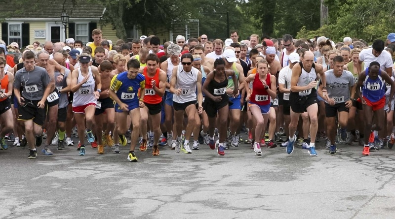 Runners take off from the starting line for the Little Compton Road Race at the United Congregational Church Fair in Little Compton, Saturday. Photo by Bill Murphy.